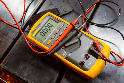 You can test a voltage regulator with just a voltmeter or multimeter